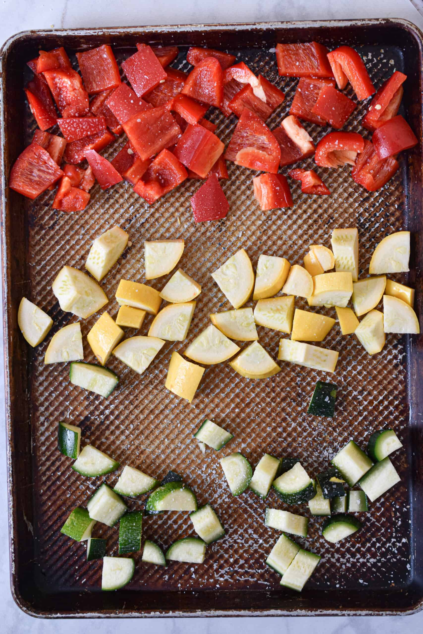 Cut the vegetables into bite sized pieces and roast for 20 minutes