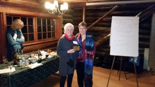 Lizz Lindsay, left, receives her Good Neighbour 2014 plaque from LVLife editor Peggy Trendell-Jensen.