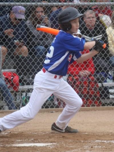 Pacific Little League's Ben Grant smacks a hit against Federal Way.