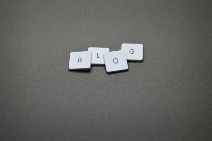 """The word """"blog"""" is spelled out in Scrabble-typle blocks."""
