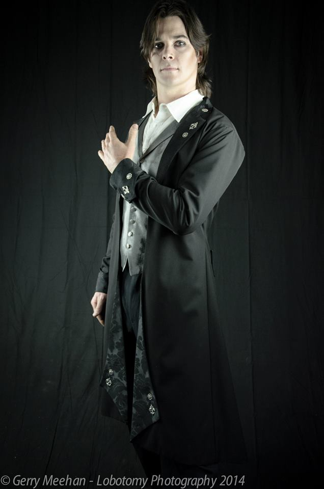 Black brocade and wool gothic Victorian coat