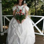 White silk corseted wedding gown with embroidered flowers