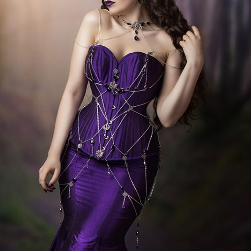 La Esmeralda purple silk corset and fishtail skirt with silver chain and crystal web