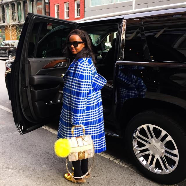 Kenyan fashion blogger in designer fashion items
