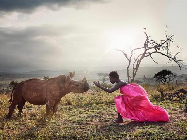 Olivia Sang | My Love For Modelling And The Realities Of It - Lysa Magazine Model Olivia Sang posing in the wild with a rhino
