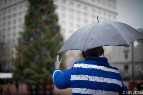 portland photos - portland pictures - portland images - christmas in portland - pioneer courthouse square - christmas tree - christmas sweater - man with umbrella
