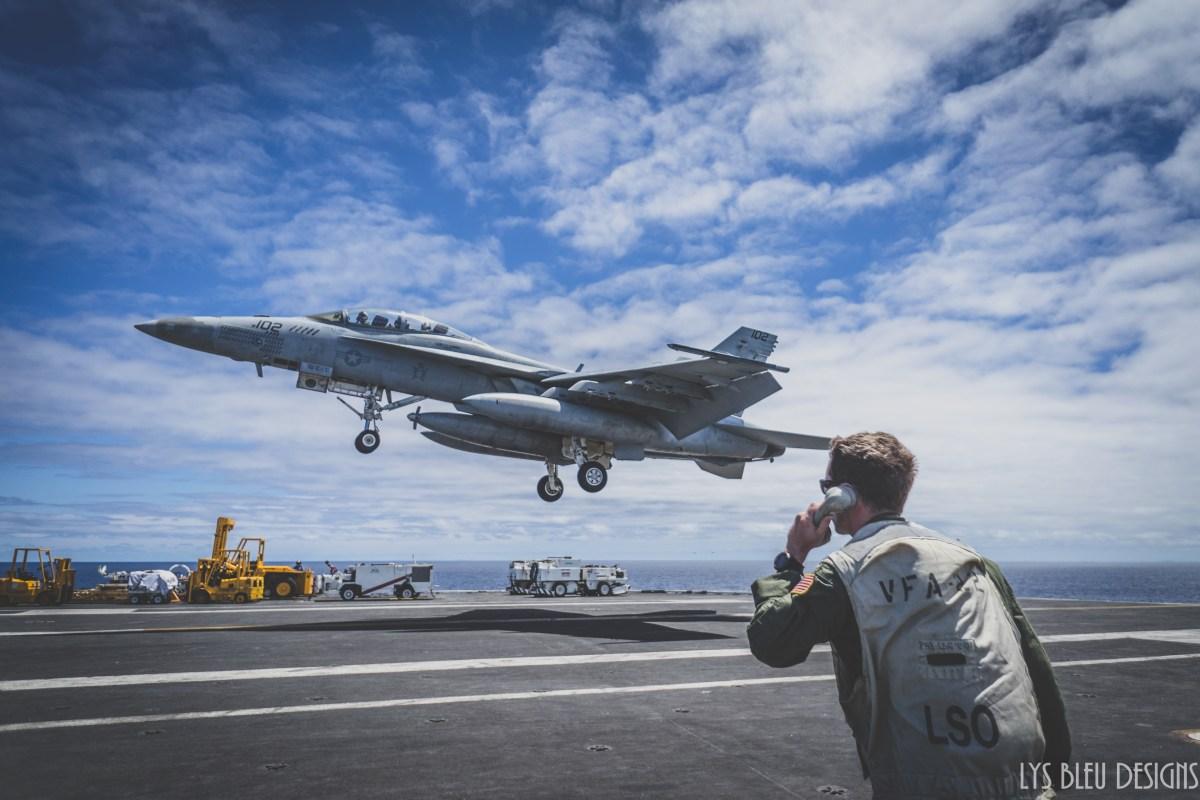 navy photos - photo of fighter jet - aircraft carrier - f/a 18 super hornet - landing signal officer - pilot - plane - jet - landing