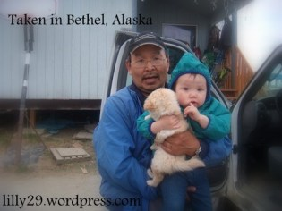 Father Holds Child