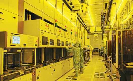 Inside a TSMC fab where the lights are yellow to protect the safety of the wafers being produced - TSMC reportedly asked by the U.S. to build a total of six fabs in the states