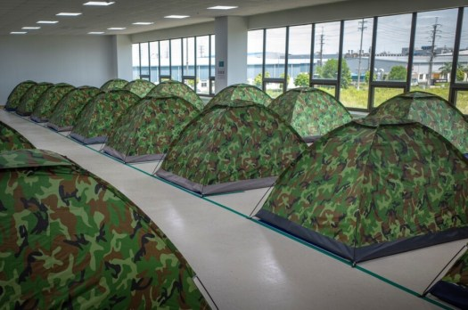 Tents sent up on the floor of a factory in Vietnam - Apple, Samsung suppliers in Vietnam have sleepovers to prevent COVID-19 from cutting production