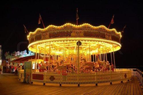 3847812-carousel-illuminated-at-night