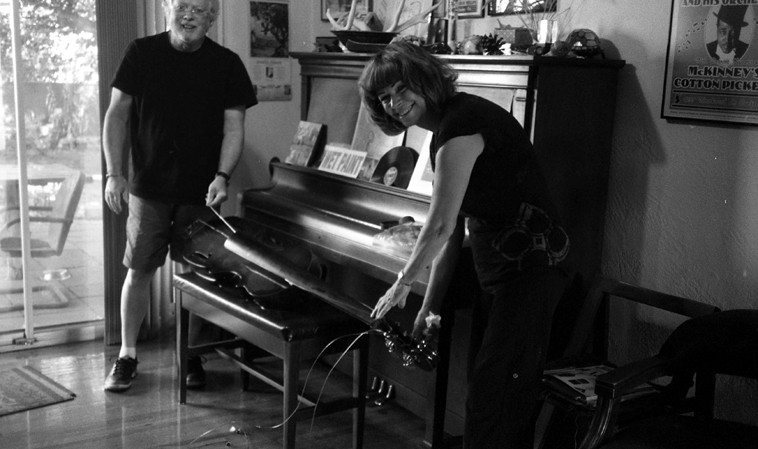 Clyde Reed and his bass technician (wife) Sherrill King assembling the travel bass, an Eminence EUPB (Electric Upright Portable Bass) -- Clyde points out that this is not a stick bass, because the Eminence has a hollow body and a sound post -- September 20, 2o12 at my place -- photo by Mark Weber