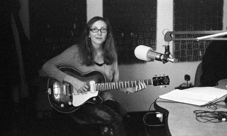 Mary Halvorson guest on my radio show December 19, 2o13 ------ photo by Mark Weber ------  she was in town with her Quintet to play the Outpost ------ I can't remember what she said that  guitar was, but it's not what it says on the headstock ------ note the ElectroVoice RE-20 microphones  we use in that broadcast studio, the best!