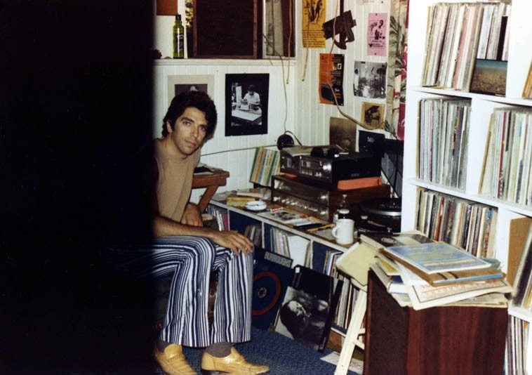 """Here I am in my old house in the alley in Upland California, age 27 -- August 1981 -- Note my photo of Malachi Favors on wall behind AND on the floor Connie Crothers first album PERCEPTION which was in constant rotation those days ----- I had only known Connie's name in association with Lennie Tristano but as wyrd weaves its ways into your life, one day I'm in a supermarket and there's a box up by the cash register that has only about 50 various albums all for 99 cents ---- Now, let me explain: Record albums are not sold in supermarkets in Southern California (except during the Tijuana Brass craze of the early 60s and you'd find those in supermarkets) mostly supermarkets are for food (or as food industry observer Michael Pollan says: Never venture into the aisles, that's where the horror begins, where all the processed """"foods"""" are, just stick to the edges of supermarkets where the vegetable department is, and the meat, and the dairy) ---------- SO, I'm standing in line and there's these albums, and here's this Connie Crothers, and it's a reputable label --Inner City-- and what's it doing here? It must have been an insurance recoup from a truck accident? and so I bought one, took it home: a Saturday near Noon, put it on the stereo and it blew my mind, completely unexpected actually (I was somewhat jaded those years after the onslaught of music I'd been tearing through -- I was, as Bob Dylan calls it: a musical expeditionary, still am) ---- and this trio of Connie's was like someone crawled inside my head and played music the way I always wanted to hear it --- I was Los Angeles correspondent to CODA and the next annual Writers Choice I listed it in my ten favorite records of 1982 ---- Wyrd is Anglo-Saxon/Northern European concept of Fate ---- little did I know at the time how much the music of Connie Crothers would intertwine with my future. (we'll be at The Stone on August 23, 2o14)"""
