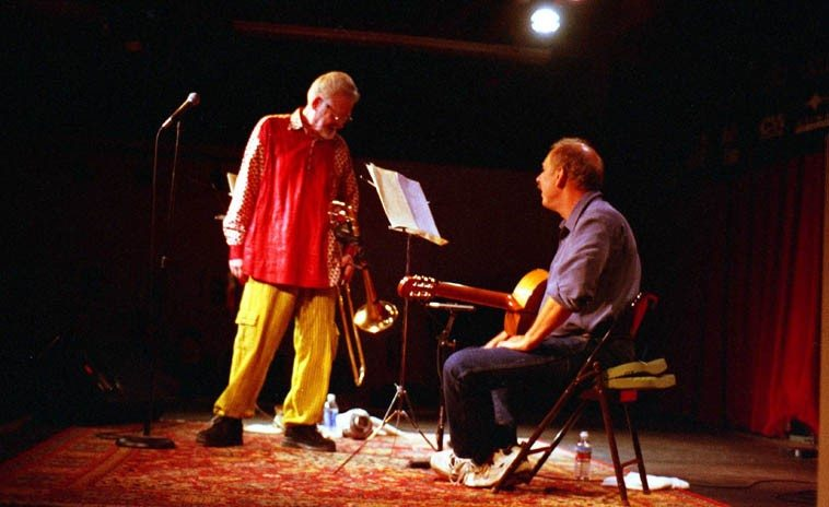 Roswell Rudd in duet performance with Duck Baker (who once reviewed a poetry CD of mine and said that I was no Kenneth Patchen of which my friends are still giving me a hard time) -- March 28, 2004 -- Outpost Performance Space, Albuquerque -- photo by Mark Weber