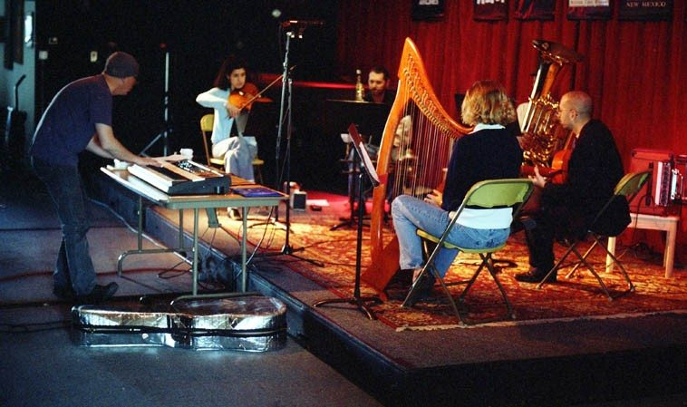 An early version of J.A. Deane's Out of Context -- Tom Guralnick, soprano saxophone; Mark Weaver, tuba;  Alicia Ultan, viola; Stefan Dill, guitar; Dino, keyboard sampler; Courtney Smith, harp -- rehearsal session  at old Outpost ---- December 14, 1997 Albuquerque -- photo by Mark Weber