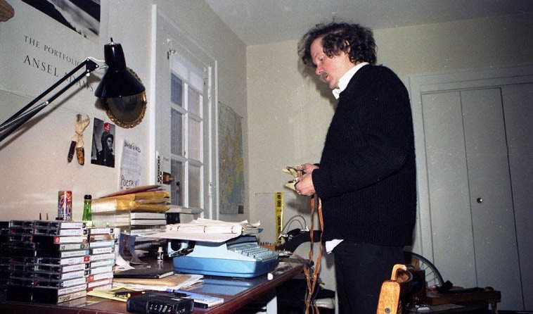 "Ed Sanders rehearsing for his performance at ""days of rain & fire: d.a. levy 20 years after,""  Case Western Reserve University, Cleveland, Ohio -- October 7, 8, 9, 1988 -- Ed was staying  with us at our apartment in Coventry and that's my writing desk in the picture -- photo by  Mark Weber --- October 8, 1988"