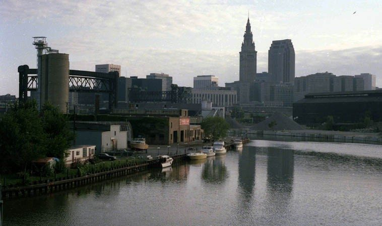 d.a. levy was a poet of Cleveland ----- The Flats, Cuyahoga River near it's joining Lake Erie, downtown  Cleveland, Terminal Tower & Sohio Building (now it's called something else) -- photo by Mark Weber --  July 30, 1986