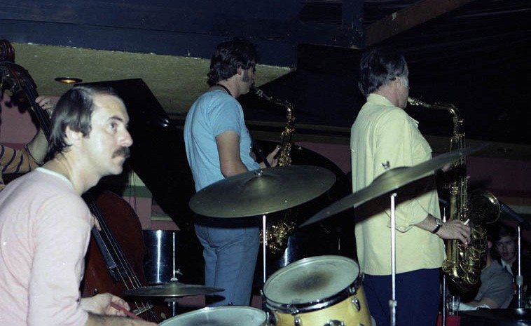 """Warne Marsh - Pete Christlieb Quintet -- October 7, 1976 -- Donte's, North Hollywood -- I sometimes think only musicians really get what Warne is doing, and by extension, possibly only saxophonists really get what's going on ---- Warne was so involved in chords and complicated exercises in time . . . (for example it was years before I found out that his tune """"Two Not One"""" meant that the first note you hear is actually the second note in the measure, which means I was already off in my count from the get-go) ---- photo by Mark Weber ---- Quintet this night was Lou Levy, piano; John Dentz, drums; Fred Atwood, bass"""