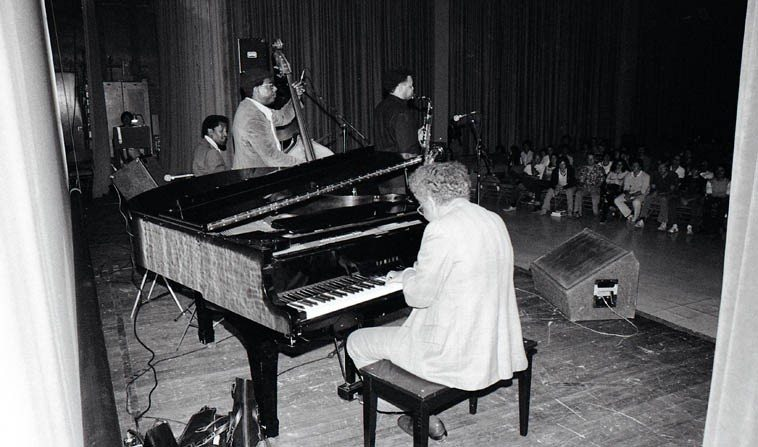 Jimmie Smith, drums; Larry Gales, bass; Plas Johnson, tenor saxophone; Dolo Coker, piano ----  UCLA Ackerman Grand Ballroom -- May 14, 1980 -- photo by Mark Weber ----Dolo was a bopper of  the first rank, he moved to Los Angeles in 1960 and became a mainstay on the scene working in  television and in the clubs w/Dexter, Pepper, Leroy Vinnegar, Teddy Edwards, Blue Mitchell, Harry Edison,  Frank Butler, Herb Ellis, Supersax, etc ---- it's hard to believe he only lived to age 56, he always  seemed so senor to me when we talked, but brain cancer took him out in 1983 -- I have some great  records of him we'll spin on the New Mexico airwaves