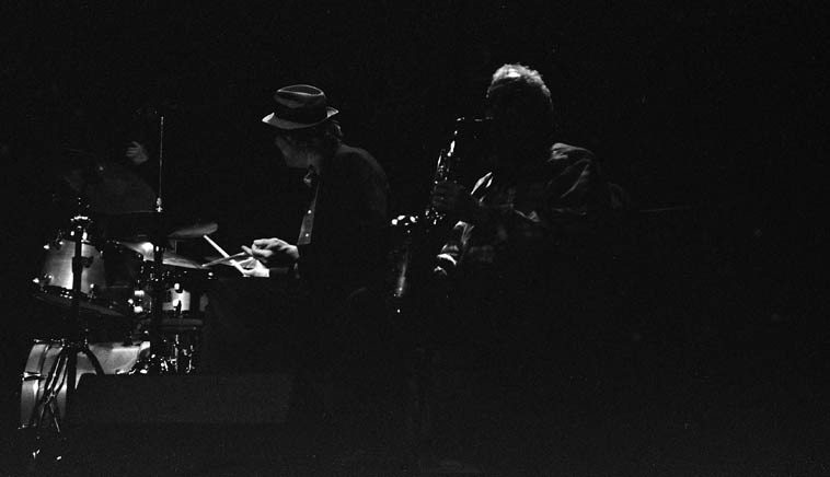 """Lee Konitz Quartet in Albuquerque ---- March 12, 2o15 ---- George Schuller, drums; Dan  Tepfer, piano; Jeremy Stratton, bass -- photo by Mark Weber ---- Before Lee arrived the rumor  was that he has been singing on his performances, and I'm happy to report his """"syllabification,"""" (Lee's word)  which strikes me as the most  correct term for his way with vocalization (rather than scat) was wonderful, it struck me (if I may  be permitted to stray into the realm of psychoanalysis) as a person in their later years returning to  something of his youth: Lee's being his early studies with Lennie ---- (""""We are all of us palimpsests, we  carry the past around, it comes surging up . . ."""" -- Penelope Lively) ---- And his tone on the alto  was deeply heart-felt, a beautiful human sound ---- James Newton, who was in attendance (he and  George have a Dolphy connection) said to me about Lee's sound: """"Every note has so much history in it, wow"""""""
