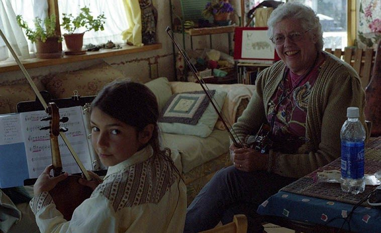 Sadness in this photo: That young child was on her way to becoming  the world's greatest jazz violinist when she was killed in a small  prop plane accident (May 23, 2o14) All of Silver City mourned --  Ella Jaz Kirk with her teacher Jeanie McLerie at Fiddle Hill -- February 5, 2oo8 -- photo  by Mark Weber