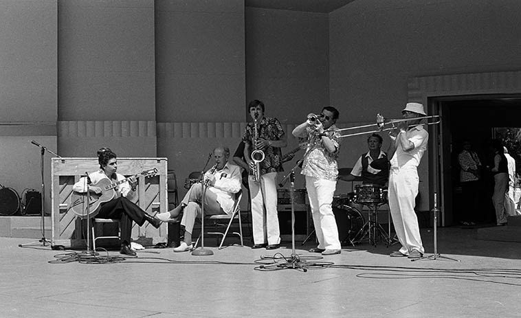 Rosy McHargue & Dixielanders (8-pc) -- MacArthur Park Bandshell, downtown Los Angeles -- August 9, 1981 -- Rosy, clarinet & vocals; Jimmy Adams, cornet; Herbie Harper, trombone; a very young Howard Alden on guitar (age 23, well, not that young); Bob Reitmeier, tenor; Burr Middleton, drums; (Vinny Armstrong, piano; Marty Corb, elec-bass guitar) -- photo by Mark Weber