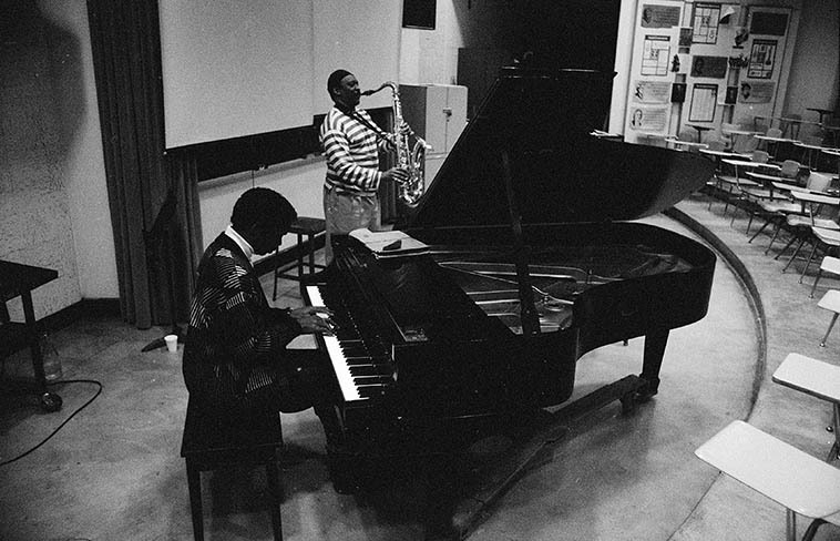 "Don Pullen and George Adams afternoon music clinic at Tri-C Jazz Festival, Cleveland, Ohio -- April 7, 1989 -- photo by Mark Weber ----------- When I asked them about all that bluster from Charles Mingus on stage, when Mingus would yell out directions like a madman: ""B FLAT MOTHERFUCKERS!"" they told me that Mingus was a pussycat and all that was for show ------- My hair always stood straight up and I was quaking in my boots"