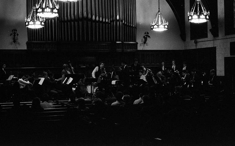 """Ernie Krivda (tenor saxophone) performing his """"Resurrection -- Concerto for Saxophone & Jazz Orchestra"""" plus his quartet (Jeff Halsey, Chip Stephens, Joe Brigandi) w/ 31-pc. Case Western Jazz Ensemble (conducted by Stephen Miller) -- November 7, 1986 at Harkness Chapel, Cleveland -- photo by Mark Weber"""