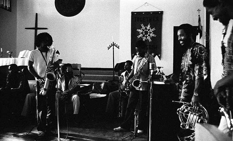 """Pan Afrikan Peoples Arkestra at I.U.C.C. -- June 28, 1981 Los Angeles -- Left to right: Gary Bias (alto); Ufahamu Uweizi (alto -- obscured behind Sabir); Sabir Matteen (tenor solo spot); Dr James Benson (tenor); Ernie Roberts (baritone sax); Arthur Wells (tenor); Fundi LeGogn, (French-horn); Ernie Roberts (bass clarinet -- edge of frame) ---- photo by Mark Weber ----- I remembering knowing Mr Matteen as """"Sabia"""" in these days, so, next time I run into him in NYC I got to ask . . . . I'm pretty sure that Horace used to address him as Sabia . . . . ?"""