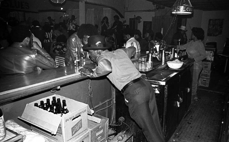 Smokey Wilson getting the word from his doorman (that's wife Celie in background, tending bar) at the Pioneer Club -- April 19, 1980 -- photo by Mark Weber