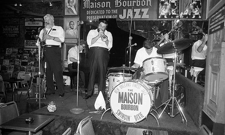 Never forget the tip jar! ---- Super City Jazz Band -- June 27, 1982 at Club Maison Bourbon in the French Quartet, New Orleans -- Glen Wilson (tenor saxophone & clarinet), Rusty Gilder (bass), Bud Brashier (piano), Murphy Campo (trumpet & vocals), Paul Ferrara (drums) -- photo by Mark Weber