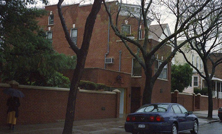 Louis Armstrong's house & museum in Corona, Queens, NYC -- December 7, 2004 -- (that's Connie Crothers under that umbrella) -- photo by Mark Weber