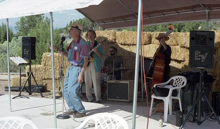 Poet Larry Goodell telling it like it is in Placitas, New Mexico, with Joshua Breakstone (guitar), John Trentacosta (drums), David Parlato (bass) -- September 13, 1998 -- photo by Mark Weber