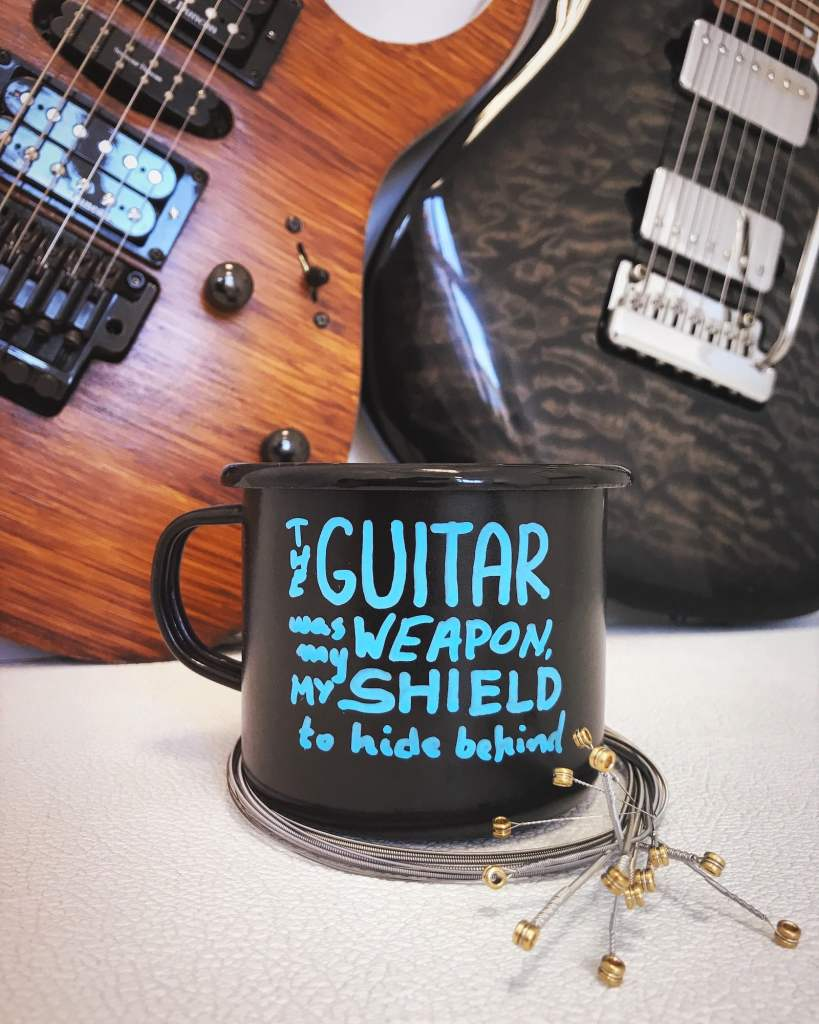 """""""The guitar was my weapon, my shield tohide behind"""""""