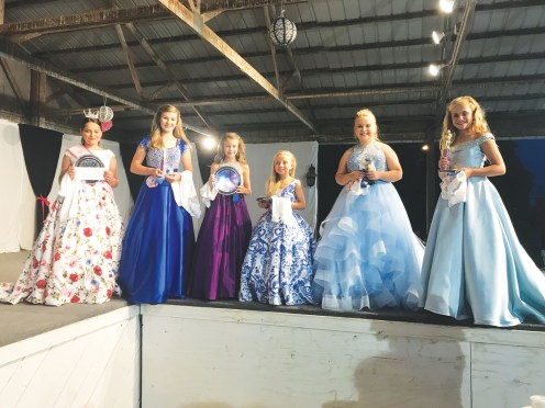Miss Preteen pageant winners line the stage. Far left is Miss Preteen Sveta Hopper.