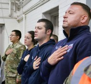 Robin Hart/robin.Hart@amnews.com Several U.S. Army Guardsmen and EMS staff say the Pledge of Alliegence on Monday.