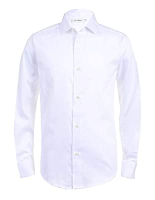 Designed with lightweight, soft sateen cotton and polyester, Calvin Klein dress shirt features a modern fit with solid design, long sleeves, buttoned cuffs, button-down closure, shirttail hem and two replacement buttons CK button-down shirt comes in ...