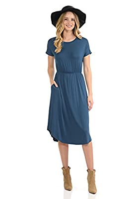 This beautiful dress features banded round neckline, drop shoulders, elastic waist and concealed side pockets. It is made with soft jersey knit that has gre1at drape. 95% Rayon 5% Spandex Made in USA Model is wearing size Small. Fit true to size. Han...