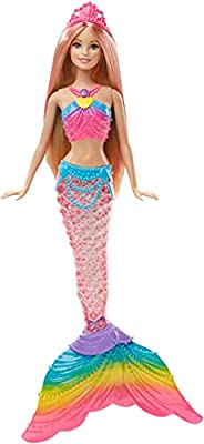 Make a real splash with this magical light-up Barbie mermaid doll! Dip Barbie Rainbow Lights Mermaid doll into water to see her mermaid tail glimmer with colorful lights inspired by a sparkling rainbow! Press the button in Barbie doll's necklace to s...