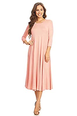 *WARNING: Our apparel are made in the United States, please double-check the company you are buying from at cart check out and avoid any that are shipping from China.* Paneled Solid Floral Print, a-line midi dress with round neck, and 3/4 length slee...