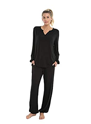 Ultra-soft luxe Milk Jersey material lounge set for a tranqil and relax feeling. Long sleeved top with v-neckline and shirttail hem and pants with drawstring tie waist and pockets. Elastic cuff sleeves and pant hems. Perfect for casual or sleep wear....