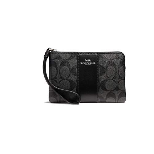 """Size Approximate Measurements: 6 1/4"""" (L) x 4"""" (H) Signature coated canvas with leather trim Inside multifunction pocket"""
