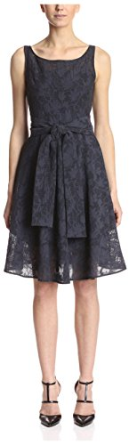 Sleeveless A-line dress in floral lace featuring self tie at waist and bateau neckline Hidden back zipper