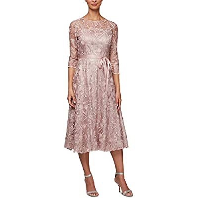 100% Polyester Imported Zipper closure Hand Wash Midi length embroidered A-line dress with illusion neckline, 3/4 sleeves and tie belt