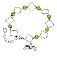 Eye-Catching Bracelet Feature Interlocking Links Adorned with Team Colored Primary Logo Charm Finished with Team Colored Beads to Add a Pretty Pop of Color Features Lobster-Claw Clasp, Ensures Secure Fit Show off Your Team Spirited Style!