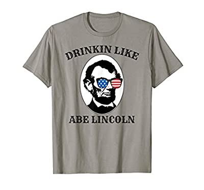 This awesome Drinking Like Abe Lincoln drunk USA American Flag Summer party design is perfect for those that like to drink alcohol on a beach with the ocean. Relax on your summer vacation with this creative red white and blue design. If you or someon...