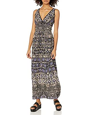 Sleeveless maxi in allover print featuring deep V-neckline and wide smocked waistband