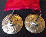 Tibetan Buddhist Hand Bells embossed with the Mantra of the Buddha of Compassion 'OM MANI PADME HUM' ;Hail to the Jewel in the Heart of the Lotus; 65cm Diameter. Comes in a Red Satin Drawnstring Carry Pouch - sold by Spiritual Gifts. Usually dispatched ..