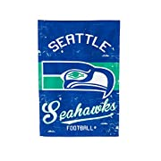 SUPPORT YOUR TEAM IN STYLE: Show your pride loud and proud with this gorgeous vintage double sided house flag. Seattle Seahawks fans will enjoy a navy and green flag with the vintage Seahawks logo printed in the center. The heat transferred football ...